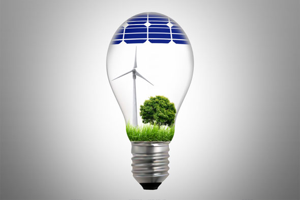 Sustainable development, light lamp with tree, windmill and solar cells.